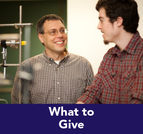 Riollver image of a teacher and student in the Science lab. Link to What to Give.