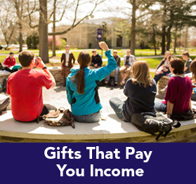 Rollover image of a class outside. Link to Gifts That Pay You Income.